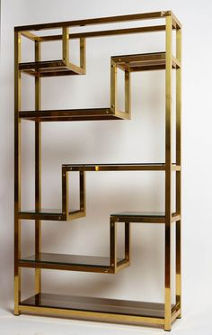 Geometric bookshelf made in the '70, talian manufacture. Shelves in smoked glass.