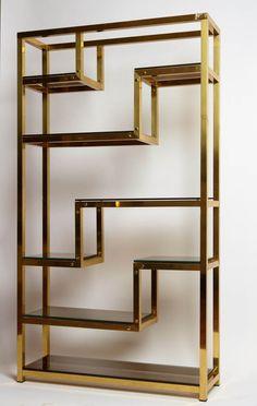 Geometric bookshelf made in the '70, talian manufacture. Shelves in smoked glass.