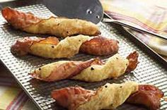 BROWN SUGAR PEPPERED BREADSTICK TWISTS      1/4  cup  packed   tsp.  cracked black pepper  1  can  (11 oz.) refrigerated soft breadsticks  1  pkg.  (2.52 oz.) OSCAR MAYER Fully Cooked Bacon