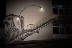Here's a fun piece from last April by Norway-based artist Skurk who turned the light fixtures of this stairwell into a creepy anglerfish that lights up at night.