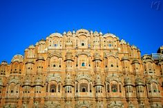 """Hawa Mahal Wind_Palace, Jaipur, Rajasthan, India    The Hawa Mahal - """"Palace of Winds"""" was built in 1799 in the shape of the crown of the Hindu deity Krishna.The palace is a five-story pyramidal shaped monument that rises to a height of 50 feet (15 m) from its high base,Built of red and pink sandstone, the palace is situated on the main thoroughfare in the heart of Jaipur's business center."""