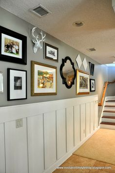 Love the personality the faux deer brings to this collage wall.