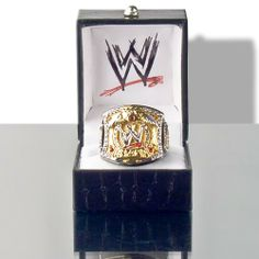 """WWE Spinning Championship Replica Finger Ring (Womens Size) by WWE. $60.00. Officially Licensed WWE Spinning Championship Belt Replica Womens Size Finger Ring. Made by Figures Toy Company, The """"W"""" center plate really spins and the ring contains numerous faux diamonds. The ring is made of brass to simulate the gold and also is finished with black hematite to simulate the belt strap. The ring has an adjustable shank that fits rings Womens size 3 to 9 with ease. Ring is ship..."""