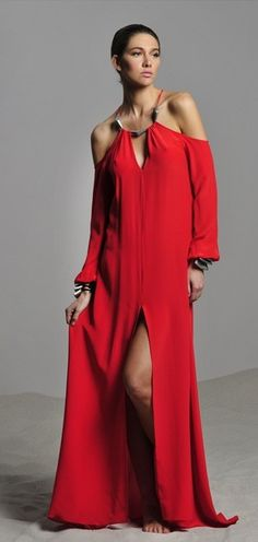 Alexis- Kristina Dress. This Long V-Neck Dress Features a Front Slit and Metal Trim