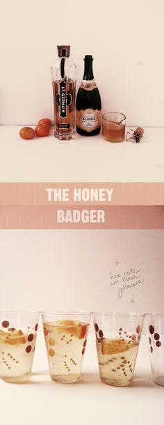 Honey Badger: champagne, st germaine, honey syrup, and orange slice