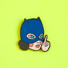 This is a pin inspired by enid coleslaw from the film version of ghost world where enid wears the bat girl latex mask. The perfect pin for any ghost