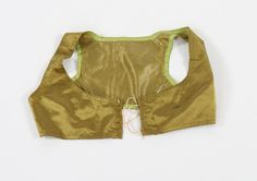 An olive green satin bodice, circa 1810. with boned eyelet bands for front lacing - See more at: http://kerrytaylorauctions.com/one-item/?id=404&sub=+&auctionid=416#sthash.b8C9oVt9.dpuf