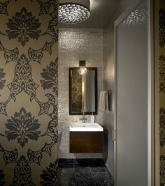 Love this wallpaper. industrial bathroom by jamesthomas, LLC