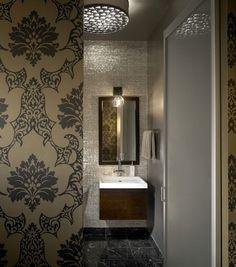 Love this wallpaper. industrial bathroom by jamesthomas, LLC