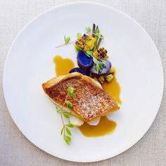 Crispy skin red snapper, purple potato, grilled corn, young spring onion, coconut ginger lemongrass dashi broth - by @gayleq ⭐️⭐️ Whoever you are and wherever you come from, we are all united by food. Join Cookniche, linking the culinary world. Direct link in profile.