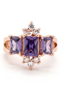Pretty rose gold ring with purple jewels.