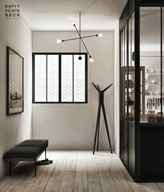 Luv the dark graphic elements in this tiny space. That lighting fixture is sumptuous!