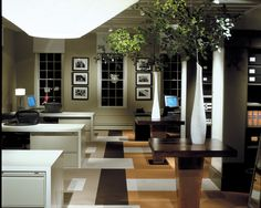I like how there are larger conference/shared tables between the columns.  Some Office interior ideas