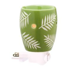 Grotto Plug-In Scentsy Warmer (non-ETL)    Grotto features a contemporary leaf pattern that pops on a kelly-green background. Plug it in and watch it glow!