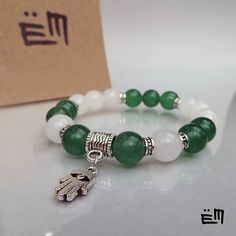 A jáde a kínai iparművészetben fontos szerepet játszó féldrágakő. Szabályozza az idegek, a vese és a mellékvese működését. Javítja a szervezet sav-bázis egyensúlyát. Ár: 3250 Ft . . . . . #elizaminerals #minerals #ásvány #ásványékszer #ásványkarkötő #kreatív #ékszer #kézműves #egyedi #hungarianjewelry #medál #kézzelkészült #kezzelkeszult #madeinbudapest #logo #jáde #jade #fatimakeze Pandora Charms, Minerals, Charmed, Bracelets, Jewelry, Charm Bracelets, Bijoux, Bracelet, Jewlery