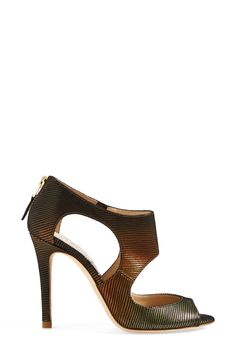Cute lizard print cut-out sandal.