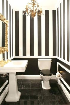 Beautiful Bathroom Color Schemes You'll Love : Luxury Black and White Bathroom with White Pedestal Sink and Fancy Gold Chandelier also Carving Gold Frammed Mirror and Black White Striped Wall Painting and Black Marble Ceramic Tile Flooring