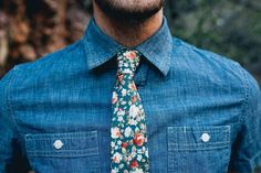 A chambray button down and a floral print tie with khakis make for a comfy and casual look that won't have your fiance begging to change clothes. | Stylish Engagement Party Attire for the Groom