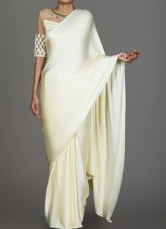 Cream Satin Saree features a net + satin embroidered blouse and features a satin saree. Handwork and thread embellishments are present on the blouse. Modern Indian Saree Click above VISIT link for Satin Saree, Chiffon Saree, Saree Dress, Sari Blouse, Indian Dresses, Indian Outfits, Indian Clothes, Indian Fashion Trends, Punjabi Fashion