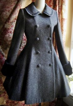 Great coat. I love a riding coat, and it's faintly Alice in Wonderland