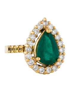 14K yellow gold cocktail ring featuring prong set pear shaped emerald at center, round brilliant diamond halo and round brilliant yellow sapphire accents at shank.