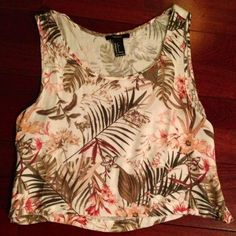 crop top Crop top with palm tree/floral pattern.  Never worn - in perfect condition.  Not from Free People, just tagging for exposure Free People Tops Crop Tops