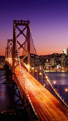 Guide to San Francisco & the Wine Country, California California Itinerary and Travel Guide: The San Francisco skyline and Bay Bridge at sunset.California Itinerary and Travel Guide: The San Francisco skyline and Bay Bridge at sunset. Wallpaper Travel, City Wallpaper, Iphone Wallpaper, Bridge Wallpaper, Iphone Backgrounds, Wallpaper Backgrounds, San Francisco California, San Francisco Skyline, California California