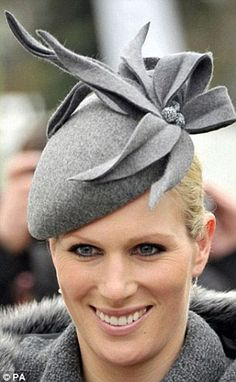 9ea364030b5 Zara Phillips wore a grey felted wool hat decorated with handmade bloom to  Cheltenham Festival last month