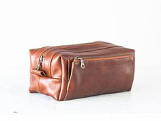This travel case is made using a superb Italian cow hide in Brown.Roomy enough to fit all your daily necessities.It features an exterior zipper pocket on one side measuring 8 x 4 (20 x 10cm) and a handle on the other side to easily grab it when needed. Inside the lining is made using a