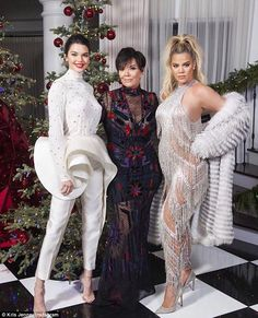 Family is everything: Khloe, who is almost six months pregnant with her first child, showed off her baby bump at her mom Kris' Christmas Eve bash; Khloe with Kris and Kendall Jenner