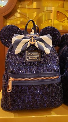 Guests voyaging on Disney Cruise Line can now commemorate their trip with a new style collection. The Disney Cruise Line Nautical Navy Collection features fashi Cute Mini Backpacks, Stylish Backpacks, Girl Backpacks, Disney Handbags, Disney Purse, Sequin Backpack, Backpack Bags, Accessoires Iphone, Disney Outfits