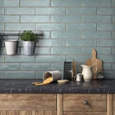 tiles Backsplash Blue-greens are trending right now, and this delicious aqua ceramic tile hits all the right notes with its handcrafted texture and shabby-chic appeal. Blue Subway Tile, Subway Tile Kitchen, Blue Tiles, Scandinavian Kitchen Backsplash, Country Kitchen Tiles, Kitchen Tiles Design, Blue Backsplash, Subway Backsplash, Ceramic Wall Tiles