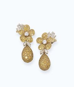 A PAIR OF COLOURED DIAMOND FLORAL EAR PENDANTS, BY VAN CLEEF & ARPELS Each designed as a detachable pavé-set yellow diamond drop to the pavé-set and vari-cut diamond floral top, mounted in 18k gold, circa 1990