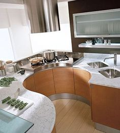 Beautiful, functional idea for a tiny kitchen. Love access to everthing in small spaces ... rounded-kitchen-with-marbal
