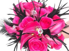 Hot pink and black - calla lilies, roses, black feathers and silver aluminum wire swirls make this bridal bouquet very hot