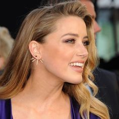 Get Amber Heard's look for less by purchasing our Crystal Striker Ear Jacket Set, available in gold and silver and only $16! Shop now at www.JewelCult.com