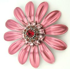 Raspberry Sorbet Colored Flower with Pink Red & Amber Colored Crystal Brooch Pin Unidos Trading Corp.. $14.95. Gift boxed in white swirl chipboard base box with clear platic lid. Raspberry sorbet colored flower. Multi colored Swarovski crystal center