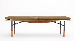 The Bench also doubles as a table. Designed by Finn Juhl in 1953 for BOVIRKE.