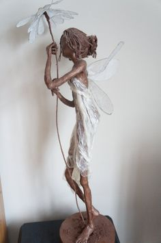 Hey, I found this really awesome Etsy listing at https://www.etsy.com/listing/175474800/daisy-garden-fairy-sculpture