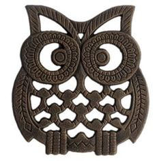 """Metal trivet with an owl silhouette.  Product: TrivetConstruction Material: MetalColor: BrownDimensions: 6"""" H x 5.63"""" WCleaning and Care: Wipe clean with damp cloth"""