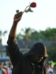 James Gilchrist of Orlando, Fla., attends a rally for slain teenager Trayvon Martin in Sanford, Fla. (Pic from NPR)