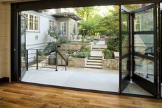 folding doors/window wall traditional garage and shed by Menter Architects LLC