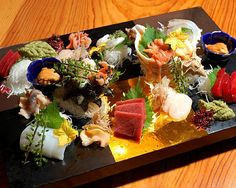 best of sashimi - toro, seafood with shells,   sushi