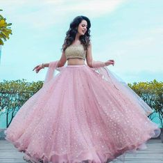You can be assured to make a great style statement with this pastel pink net lehenga choli.Buy this latest designer lehenga choli online .Paired with matching choli and dupatta. Party Wear Indian Dresses, Designer Party Wear Dresses, Indian Gowns Dresses, Indian Bridal Outfits, Dress Indian Style, Indian Fashion Dresses, Indian Designer Outfits, Latest Wedding Dresses Indian, Net Dresses