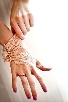 Costume gloves.  Ooo, this is lovely!  Fingerless=tough, Lace = delicate, few seams = simple, pearl details = intricate.