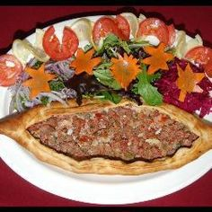 This dish is found popular in Turkey. It's very similar to a pizza, but minus the cheese, tomato purée and circular shape, and hey presto! You've got yourself a pide. Pizza Pictures, Turkish Recipes, Ethnic Recipes, Turkish Pizza, Allrecipes, Meatloaf, Quiche, Pasta, Dishes