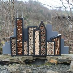 i love this design idea. although it would have to be adjusted a bit to house just mason bees, but a true city is multicultural and this design would attract a variety of different insects.