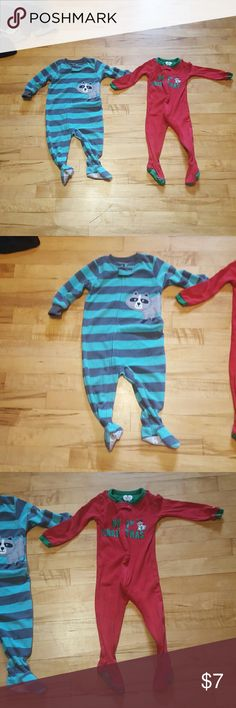 """Carter's 12 Month Like new footie PJs. Zip-up and snap. One with a raccoon and the other """"my first christmas"""". Raccoon is 12 Months and the christmas one is 12- 18 Months. Has grippers on yhe botton of the feet. Carter's Pajamas"""