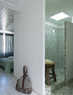 I like the painted floor in the bedroom and the tile/glass shower and skylight in the bathroom.