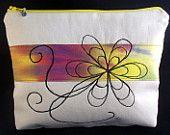 9 inch pouch. Free machine embroidered design